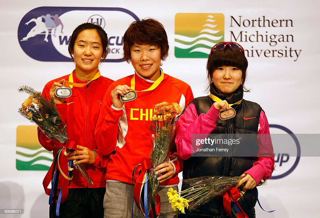 Women's 1500m gold medalist Yang Zhou of China (C); silver medalist Qiuhong Liu of China (L), and bronze medalist Eun-Byul Lee of Korea pose on the medal stand during the the ISU World Cup Short Track Speedskating Championships at the Benny Event Center on November 14, 2009 in Marquette, Michigan.