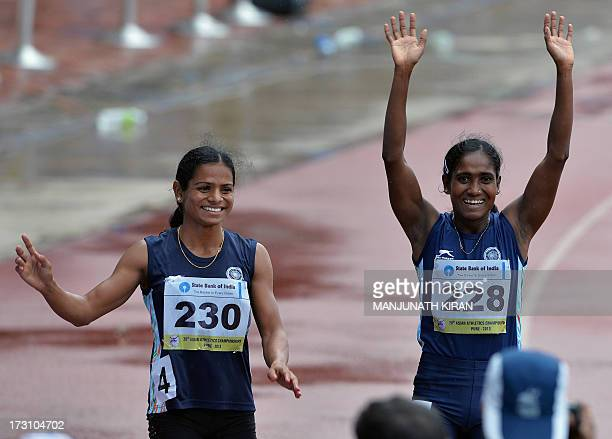 Women's 200 meters respective silver and bronze medal winners from India Asha Roy and Dutee Chand wave to the crowd after their race on the fifth and...