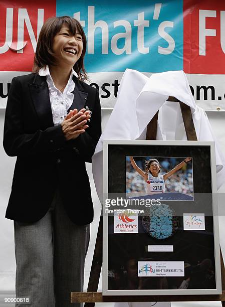 Women's 2000 Olympic Marathon winner Naoko Takahashi of Japan is presented with a plaque during a photo call ahead of Sunday's Blackmores Sydney...