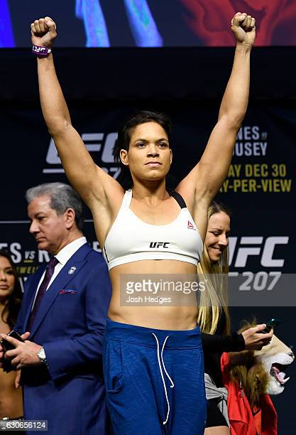 UFC women's bantamweight champion Amanda Nunes of Brazil poses for photos during the UFC 207 weighin at TMobile Arena on December 29 2016 in Las...