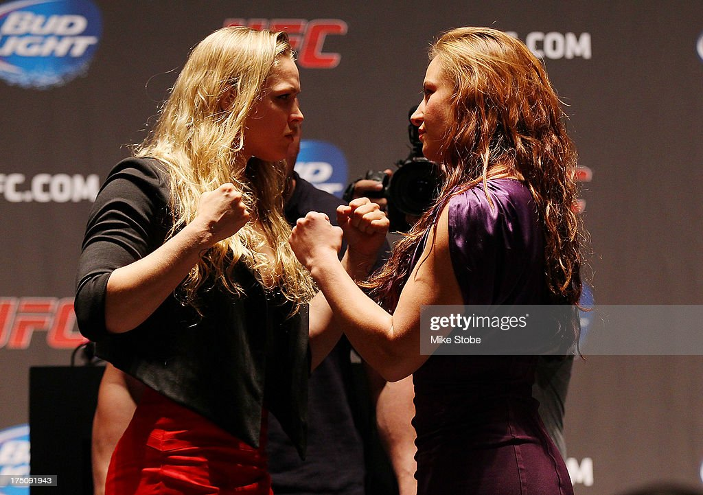 UFC women's bantamweight champion Ronda Rousey and Miesha Tate face-off at the Beacon Theatre on July 31, 2013 in New York City.
