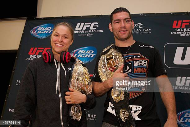 UFC women's bantamweight champion Ronda Rousey and UFC middleweight champion Chris Weidman pose at UFC 175 inside the Mandalay Bay Events Center on...