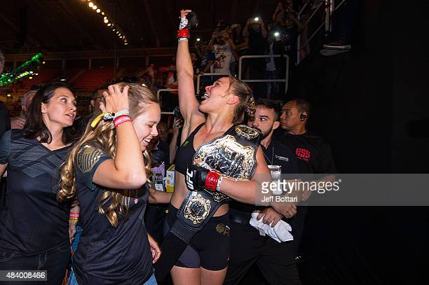 UFC women's bantamweight champion Ronda Rousey celebrates with her family and fans backstage after defeating Bethe Correira of Brazil by KO during...