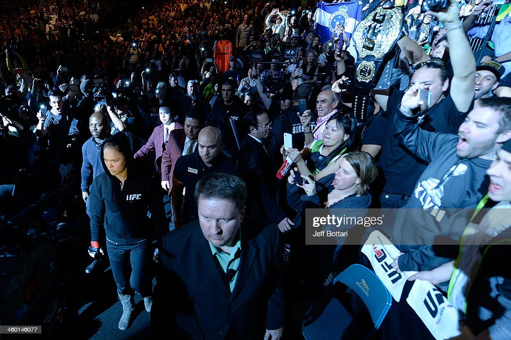 Women's Bantamweight Champion Ronda Rousey enters the arena prior to her bout against Miesha Tate during the UFC 168 event at the MGM Grand Garden Arena on December 28, 2013 in Las Vegas, Nevada.
