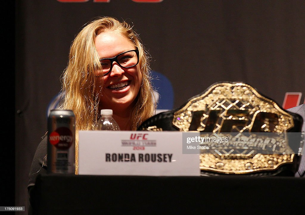 UFC women's bantamweight champion Ronda Rousey interacts with fansduring a press confernce at the Beacon Theatre on July 31, 2013 in New York City.