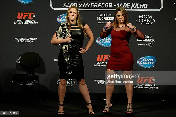 Women's Bantamweight Champion Ronda Rousey of the United States and Bethe Correia of Brazil face off as UFC President Dana White stands in during the...