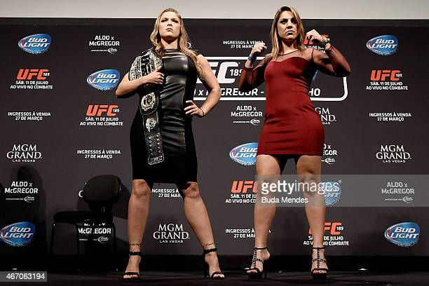Women's Bantamweight Champion Ronda Rousey of the United States and Bethe Correia of Brazil pose for the media during the 189 World Media Tour Launch...