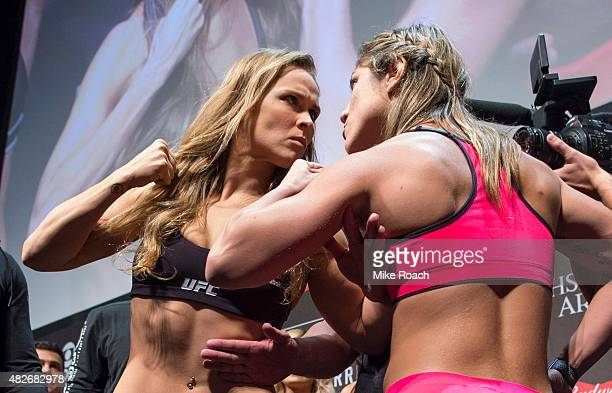 UFC women's bantamweight champion Ronda Rousey of the United States and Bethe Correrira of Brazil face off during the UFC 190 weighin event at the...