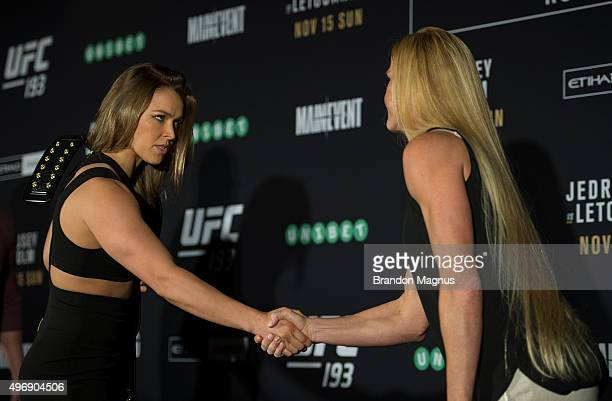 UFC women's bantamweight champion Ronda Rousey of the United States shakes hands with Holly Holm of the United States during the UFC 193 Ultimate...