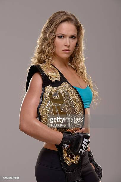 Women's Bantamweight Champion Ronda Rousey poses for a portrait during a UFC photo session on December 26 2013 in Las Vegas Nevada