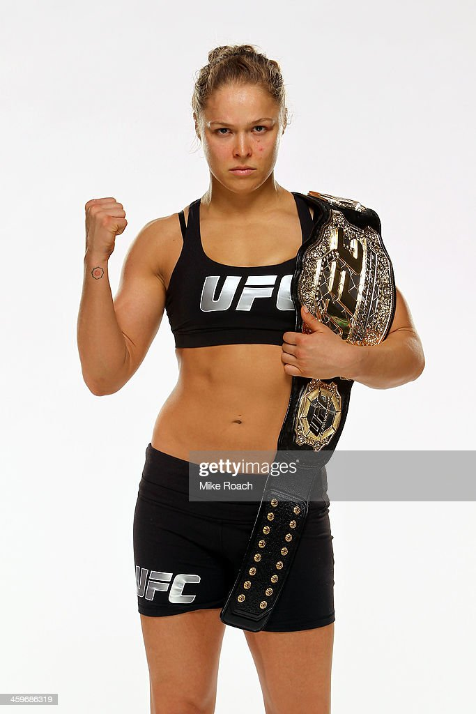 Women's Bantamweight Champion Ronda Rousey poses for a post-fight portrait after defeating Miesha Tate by taopout during the UFC 168 event at the MGM Grand Garden Arena on December 28, 2013 in Las Vegas, Nevada.