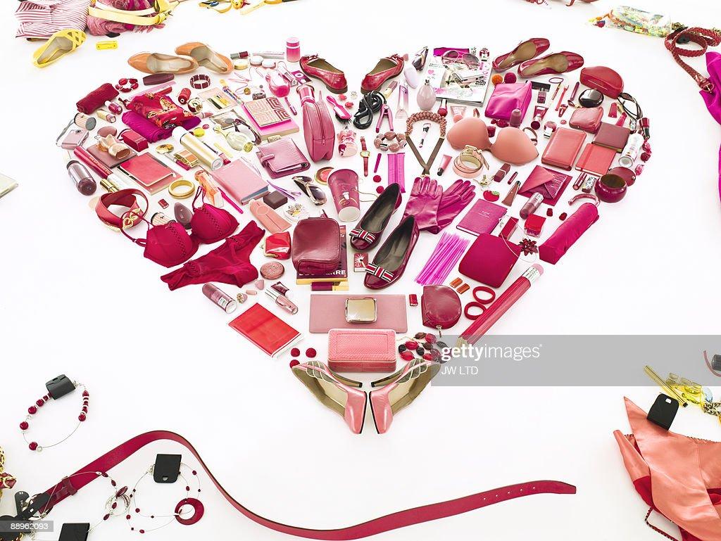 Women's belongings in shape of heart : Stock Photo