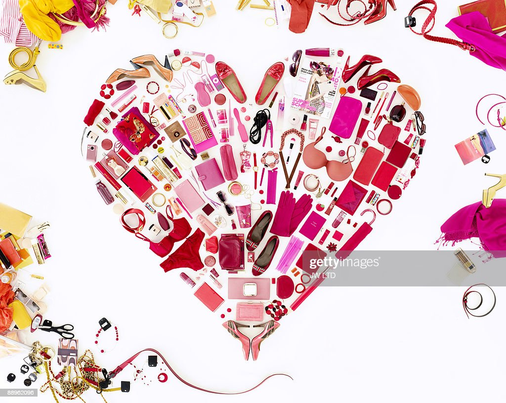 Women's belongings in shape of heart : Stock Photo