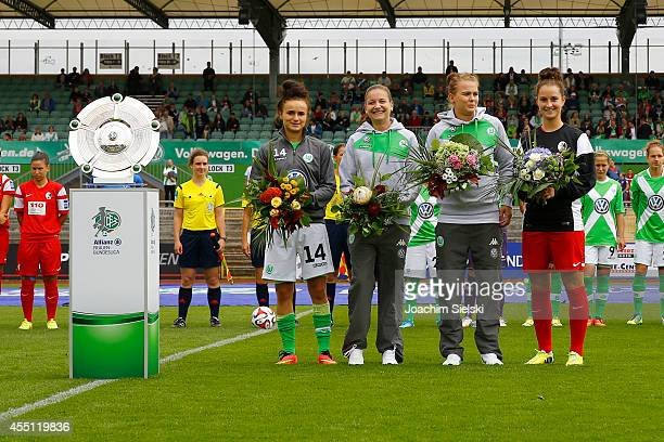 Women`s Bundesliga championship trophy Lina Magull Joelle Wedemeyer Merle Frohms of Wolfsburg and Sara Daebritz of Freiburg with Flowers during the...