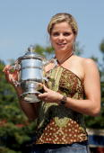 Women's champion Kim Clijsters of Belgium poses with the championship trophy after defeating Mary Pierce of France during the final of the US Open at...