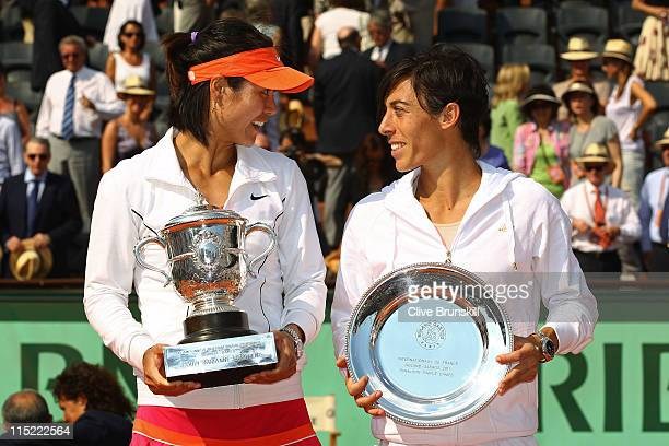 Women's champion Na Li of China and runner up Francesca Schiavone of Italy pose with the trophies during the women's singles final match between...