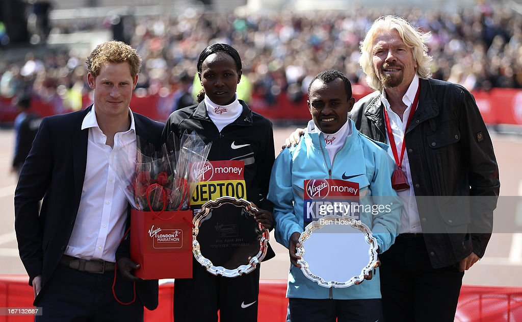 Women's champion <a gi-track='captionPersonalityLinkClicked' href=/galleries/search?phrase=Priscah+Jeptoo&family=editorial&specificpeople=7640677 ng-click='$event.stopPropagation()'>Priscah Jeptoo</a> of Kenya (2nd L) and Men's champion Tsegaye Kebede of Ethiopia (2nd R) with their trophies, pose with <a gi-track='captionPersonalityLinkClicked' href=/galleries/search?phrase=Prince+Harry&family=editorial&specificpeople=178173 ng-click='$event.stopPropagation()'>Prince Harry</a> (L) and Sir <a gi-track='captionPersonalityLinkClicked' href=/galleries/search?phrase=Richard+Branson&family=editorial&specificpeople=220198 ng-click='$event.stopPropagation()'>Richard Branson</a> after winning their respective races during the Virgin London Marathon 2013 on April 21, 2013 in London, England.