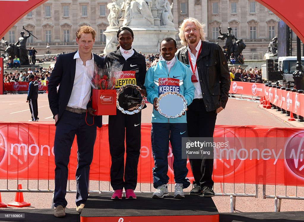 Women's champion <a gi-track='captionPersonalityLinkClicked' href=/galleries/search?phrase=Priscah+Jeptoo&family=editorial&specificpeople=7640677 ng-click='$event.stopPropagation()'>Priscah Jeptoo</a> of Kenya (2nd L) and Men's champion Tsegaye Kebede of Ethiopia (2nd R) with their trophies, pose with <a gi-track='captionPersonalityLinkClicked' href=/galleries/search?phrase=Prince+Harry&family=editorial&specificpeople=178173 ng-click='$event.stopPropagation()'>Prince Harry</a> (L) and Sir <a gi-track='captionPersonalityLinkClicked' href=/galleries/search?phrase=Richard+Branson&family=editorial&specificpeople=220198 ng-click='$event.stopPropagation()'>Richard Branson</a> after winning their respective races during the Virgin London Marathon>> on April 21, 2013 in London, England.