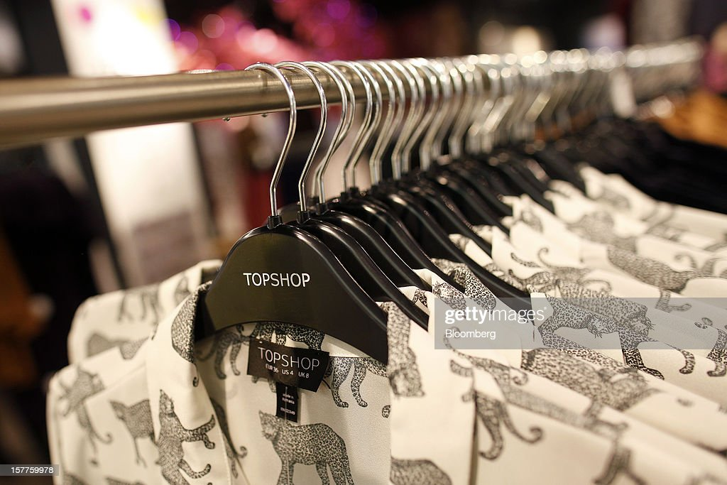 Women's clothes hang on branded-hangers inside a Topshop store, owned by Arcadia Group Ltd., on Oxford Street in London, U.K., on Thursday, Dec. 6, 2012. Philip Green, the billionaire owner of the Arcadia fashion business, sold a 25 percent stake in the Topshop and Topman retail chains to Leonard Green & Partners LP, the co-owner of the J Crew fashion brand, in a deal valuing the businesses at 2 billion pounds ($3.2 billion). Photographer: Simon Dawson/Bloomberg via Getty Images