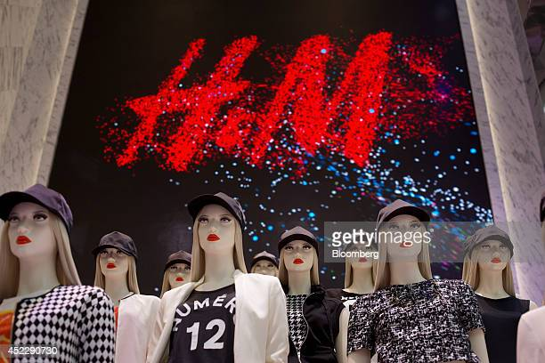 Women's clothing is displayed on mannequins during the grand opening of the Hennes Mauritz AB flagship store in New York US on Thursday July 17 2014...