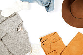 Autumn clothing essentials ideas for fashion blog look book showcase. Casual set of matching garment items. Trendy mass market apparel concept. Background, copy space, close up, top view, flat lay.