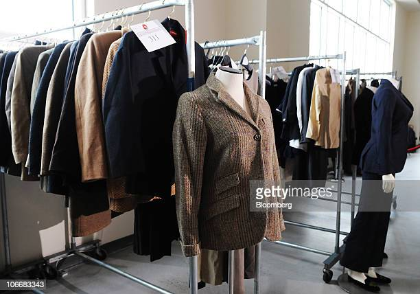 Women's designer jackets and blazers are displayed during a media preview of the auction of personal property that once belonged to Bernard and Ruth...