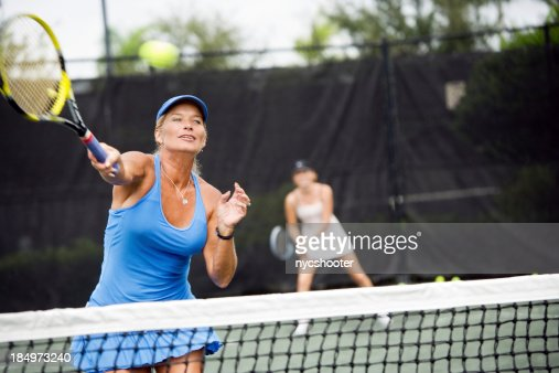 Womens doubles match tennis volley