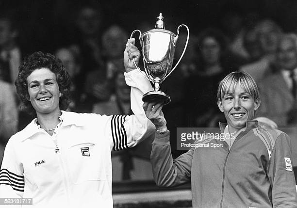 Women's Doubles tennis players Pam Shriver and Martina Navratilova hold their trophy in the air after winning the Doubles at Wimbledon Tennis...