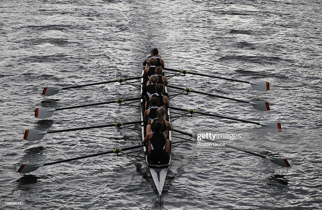 A women's Eight glides along the Charles River as rowers prepare for this weekend's Head of The Charles.