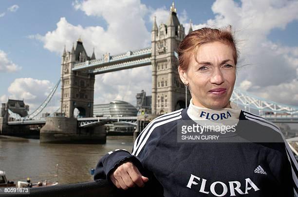 Women's elite London marathon runner Svetlana Zakharova poses for photographs in front of Tower Bridge in London on April 10 2008 She will take part...