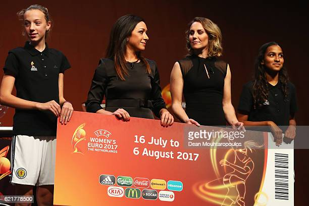 Women's EURO Final Tournament Draw Ambassador Nadine Kessler and Netherlands top scorer Manon Melis on stage with the dates and giant ticket during...