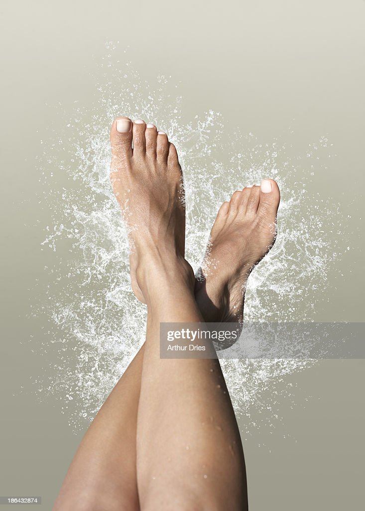 Women's feet with splash