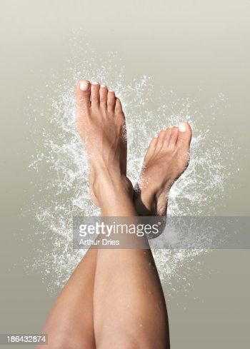 Women's feet with splash
