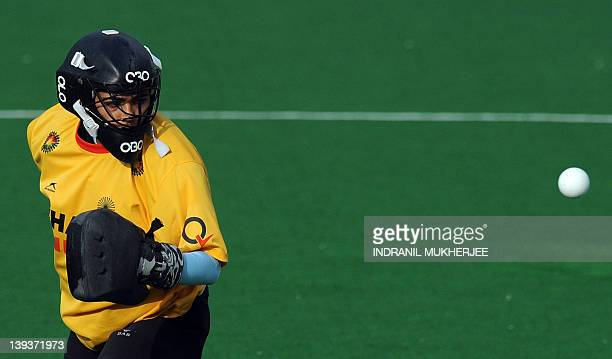 Women's field hockey team goalkeeper Savita Punnia of India watches a ball after making a save during a training session on the rest day of the FIH...