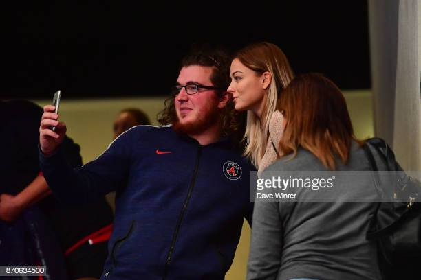 PSG women's footballer Laure Boulleau poses for a selfie with a fan during the Champions League match between Paris Saint Germain and Kielce on...