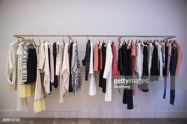 Women's garments hang from a rail inside a Maje luxury clothing store operated by SMCP Group in Toulouse France on Wednesday Feb 10 2016 Shandong...