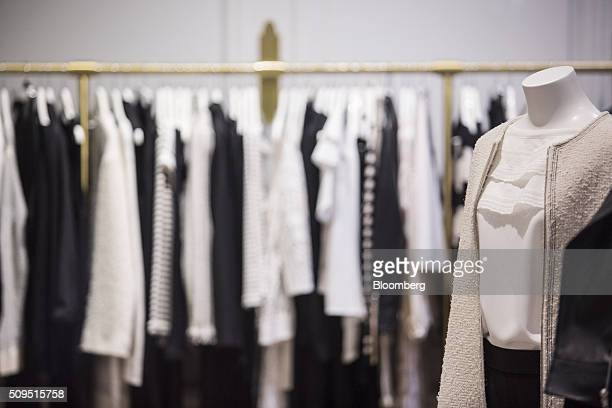 Women's garments hang on display inside a Maje luxury clothing store operated by SMCP Group in Toulouse France on Wednesday Feb 10 2016 Shandong Ruyi...