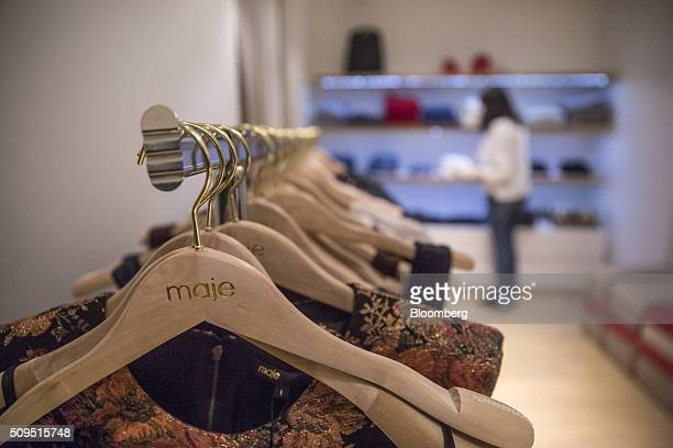 Women's garments sit on coat hangers inside a Maje luxury clothing store operated by SMCP Group in Toulouse France on Wednesday Feb 10 2016 Shandong...