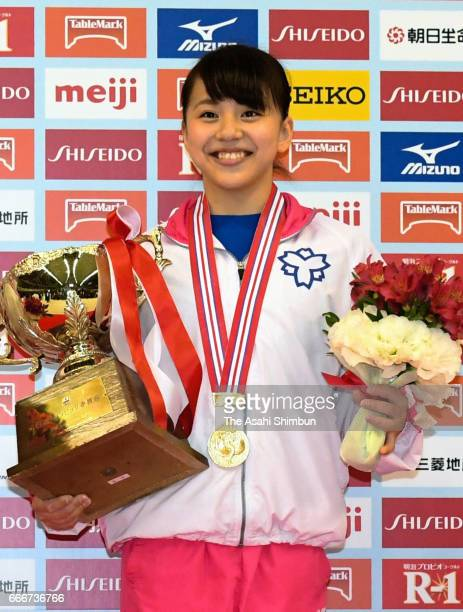 Women's gold medalist Mai Murakami poses on the podium at the medal ceremony during day three of the All Japan Artistic Gymnastics Championships at...