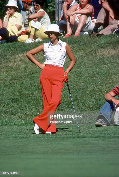 Women's golfer Hisako Higuchi leans on her club an looks on during tournament play circa 1977