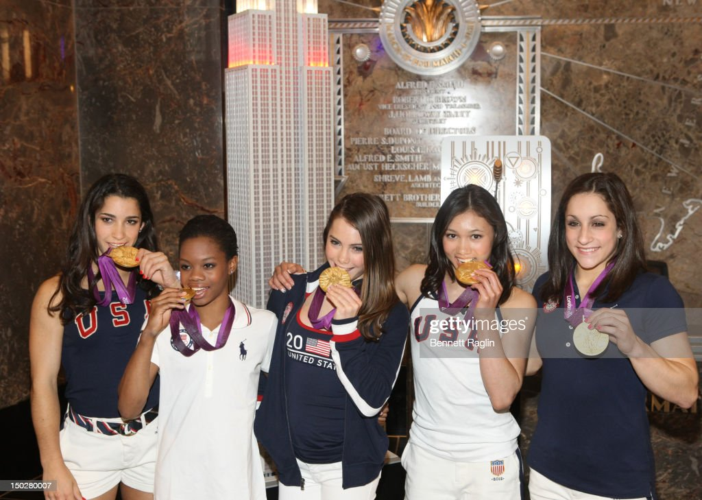 S. Women's Gymnastics Olympic Gold Medal Team(L - R) Aly Raisman, <a gi-track='captionPersonalityLinkClicked' href=/galleries/search?phrase=Gabby+Douglas&family=editorial&specificpeople=8465211 ng-click='$event.stopPropagation()'>Gabby Douglas</a>, <a gi-track='captionPersonalityLinkClicked' href=/galleries/search?phrase=McKayla+Maroney&family=editorial&specificpeople=7138673 ng-click='$event.stopPropagation()'>McKayla Maroney</a>, <a gi-track='captionPersonalityLinkClicked' href=/galleries/search?phrase=Kyla+Ross&family=editorial&specificpeople=6920700 ng-click='$event.stopPropagation()'>Kyla Ross</a>, and Jordyn Weiber pose with their medals at The Empire State Building on August 14, 2012 in New York City.