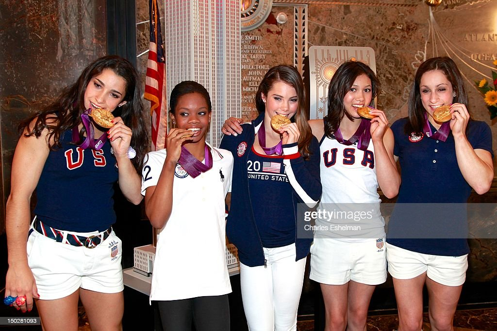 US Women's Gymnastics Team Aly Raisman, <a gi-track='captionPersonalityLinkClicked' href=/galleries/search?phrase=Gabby+Douglas&family=editorial&specificpeople=8465211 ng-click='$event.stopPropagation()'>Gabby Douglas</a>, <a gi-track='captionPersonalityLinkClicked' href=/galleries/search?phrase=McKayla+Maroney&family=editorial&specificpeople=7138673 ng-click='$event.stopPropagation()'>McKayla Maroney</a>, <a gi-track='captionPersonalityLinkClicked' href=/galleries/search?phrase=Kyla+Ross&family=editorial&specificpeople=6920700 ng-click='$event.stopPropagation()'>Kyla Ross</a> and <a gi-track='captionPersonalityLinkClicked' href=/galleries/search?phrase=Jordyn+Wieber&family=editorial&specificpeople=5720749 ng-click='$event.stopPropagation()'>Jordyn Wieber</a> pose with their medals at The Empire State Building on August 14, 2012 in New York City.