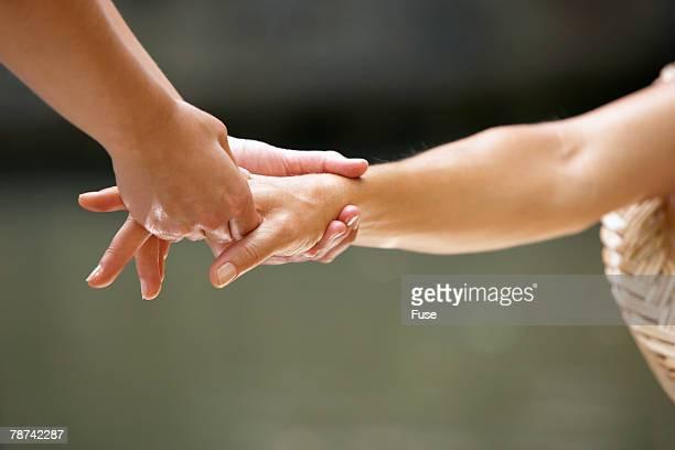 Women's Hand Being Massaged