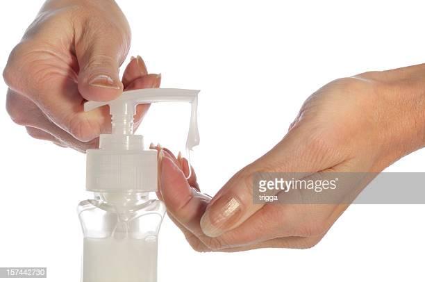 Women's hands with hand wash liquid or sanitizer