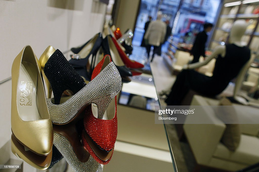 Women's high-heeled shoes stand on display inside Salvatore Ferragamo SpA's Sloane Street store in London, U.K., on Wednesday, Dec. 5, 2012. Demand for Ferragamo's shoes and other items is increasing even as China's economy slows and Europe's debt crisis weighs on consumer spending. Photographer: Simon Dawson/Bloomberg via Getty Images