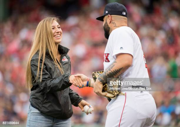 S women's hockey player Kali Flanagan shakes hands with Sandy Leon of the Boston Red Sox after throwing out a first pitch before a game against the...
