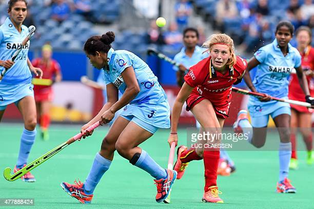 Women's hockey players India's Deep Ekka and Belgium's Stephanie Vanden Borre are pictured in action during the Group B match between Belgium and...
