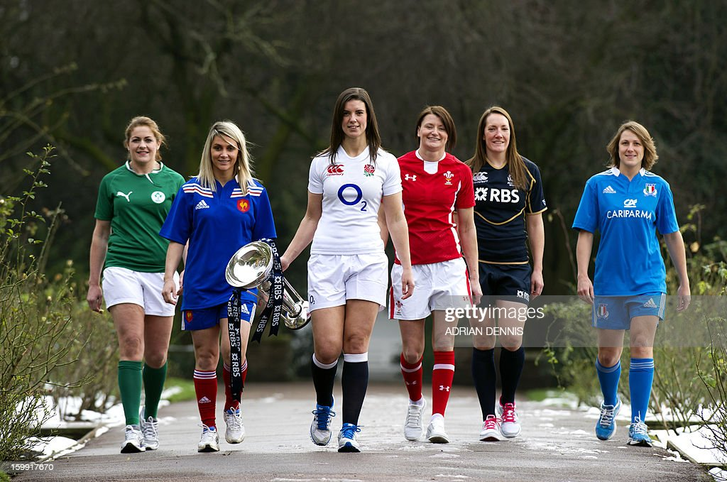 Women's International Rugby captains (from L-R) Ireland's Fiona Coghlan, France's Marie-Alice Yahe, England's Sarah Hunter, Wales' Rachel Taylor, Scotland's Susie Brown and Italy's Silvia Gaudino walk with the trophy during a photo call during the official launch of the 2013 Six Nations International rugby tournament at the Hurlingham Club in London on January 23, 2013.