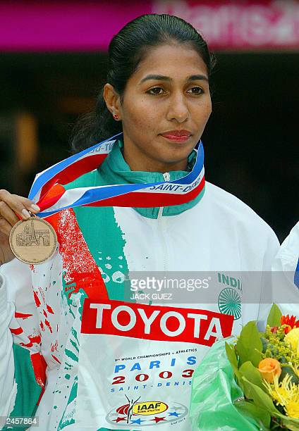 Women's long jump bronze winner Anju Bobby George of India poses on the winner's podium 31 August 2003 during the 9th Athletics World Championships...