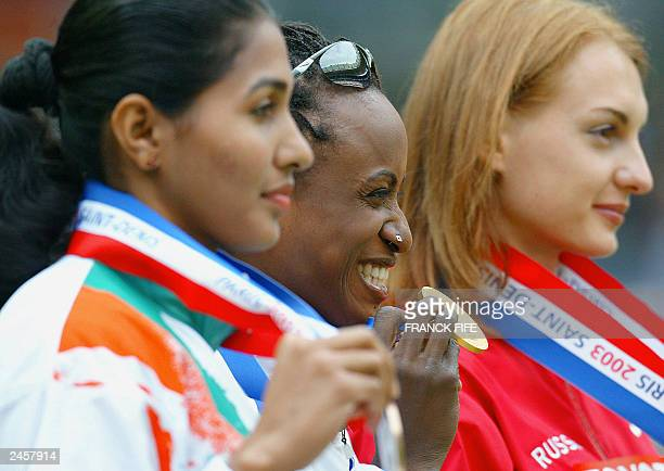 Women's long jump gold medal winner Eunice Barber of France silver medal winner Tatyana Kotova of Russia and bronze winner Anju Bobby George of India...